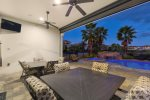 Enjoy yourself outside with company, a meal, drinks, and the TV under the covered lanai