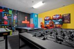 The game room is full of fun-filled activities such as an arcade machine