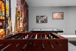 Foosball and an arcade machine up the fun that the game room provides
