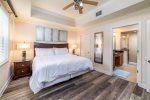 Rest well after a busy day in this master bedroom