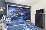 This bedroom comes with a large screen TV