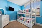 The kids will love picking their bunk in this twin/twin bedroom