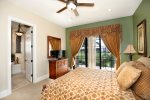 Enjoy private access to the balcony in this bedroom