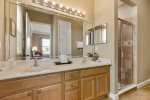 The master en-suite bathroom features dual vanity and walk-in shower