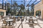 Soak up the sun with a sunny screened-in patio