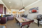 The loft area features a pool table, chess table, wet bar with sink, and a 65- inch 4K 8 Series SMART TVs