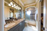 En suite bathroom with combination shower/bathtub