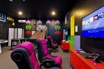 The game room has 4 gaming chairs where you can play either PS4 or Xbox One along with a Foosball table