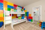 The kids will love returning to a colorful bunk bed after a busy day at the parks