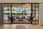 Get to the pool area through large glass doors and enjoy Florida weather