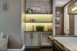 The wet bar is equipped for you to mix your favorite beverage
