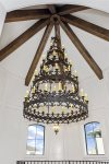 The custom Renaissance-inspired chandelier hangs beautifully from the 35-foot high ceiling