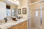 En-suite master bathroom with dual vanity and walk in shower