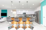 The bar table provides seating for 4 close to the kitchen in a friendly environment