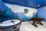 The game room will take you to another world