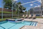 Relax by the pool on sun loungers or in the spillover spa