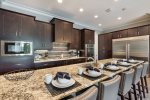 A fully equipped kitchen with stainless steel appliances