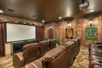 Host a movie night in the homes private theater room with a 120-inch projection screen