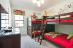 Another custom bedroom that the little ones will enjoy with twin over twin bunk beds