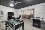 The games room features a 50-inch SMART TV, foosball table, air hockey table, and PlayStation 4