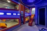 Spend all day playing in this galactic bedroom complete with a slide and your very own SMART TV