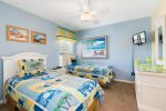The Beach bedroom has two twin beds and en-suite bathroom
