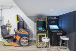 Three different arcade game systems including Golden Tee, a 60-in-1 multi-arcade game, and Madden Football