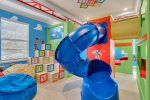 Kids will want to shrink to the size of a toy and play all day in this fun bedroom