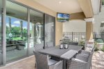 An outdoor SMART TV and plenty of patio seating