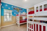 Get ready to play big in this custom built kids bedroom