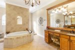 Luxurious en suite master bathroom with walk in shower and jacuzzi tub