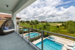 Look out onto the pool and golf course views