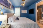 This gorgeous king bedroom features a custom floating lantern mural