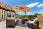Sectional sofa with fire pit and umbrella for shade