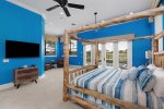 Enjoy the beach-themed bedroom complete with a 55-inch SMART TV