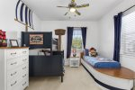 Bedroom 6 is a Pirate themed room ideal for boys or girls. It has a Pottery Barn Camp Twin-Over-Full Bunk bed and an additional twin boat bed