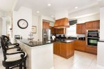 Fully equipped kitchen with custom cabinetry and granite counter tops