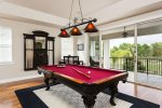 Game area with pool table and wall mounted LCD TV