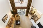 Upgraded ceiling fan and stylish window treatments