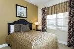 Quaint second master bedroom with wall mounted 32-Inch LED TV/DVD combo & a overhead ceiling fan