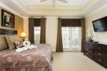 Luxurious master bedroom with 37-Inch LED TV/DVD combo & balcony access