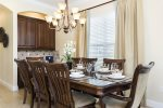 Stylish formal dining area comfortably seats eight