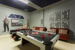 Play a game or two of air hockey and enjoy some family fun