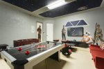 There is also a foosball table and gaming chairs which the kids will love