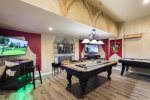 This one of a kind Harry Potter theme games room with a pool table, a air hockey table, a golden tee golf, and multi-arcade system