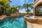 Take a cool and inviting dip in your private tropical oasis