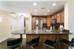 Fully equipped gourmet kitchen with upgraded stainless steel appliances