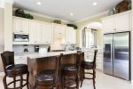 Elegant Kitchen with Stainless Steel Appliances, Granite Counter Tops, and Breakfast Bar