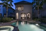 A beautiful lit pool creates an enchanting nighttime scene,