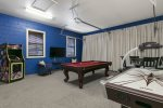 Challenge your housemates to a game of billiards or air hockey.